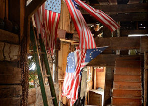 barn with flags